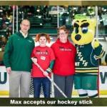 Max accepts hockey stick